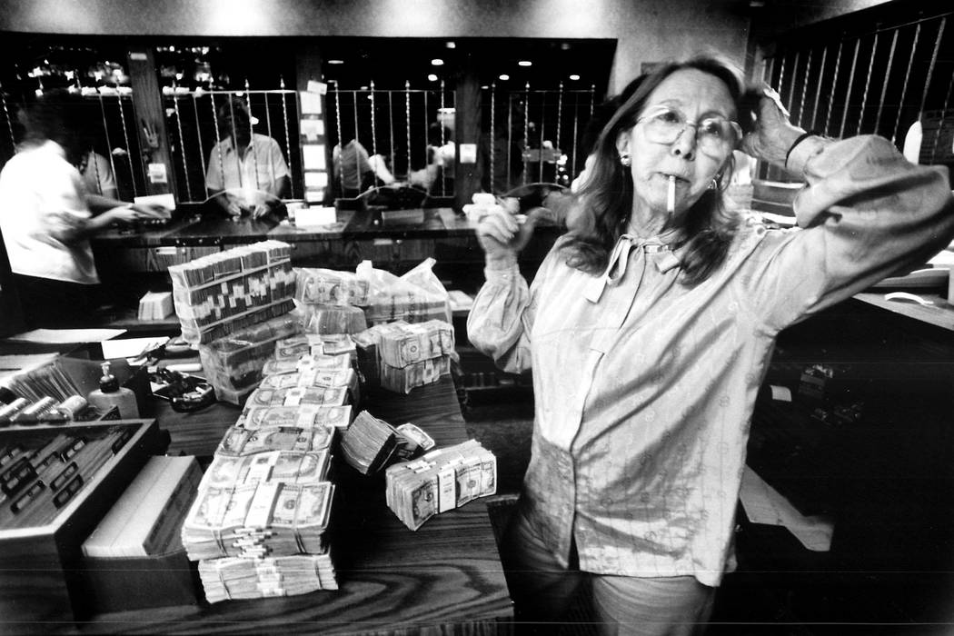 Teddy Jane Binion, wife of Benny Binion, counts $4 million before the start of a poker tournament in 1985. (File Photo)