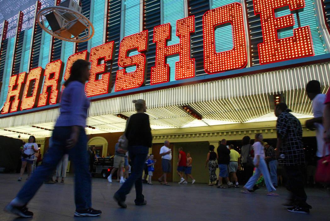 People walk into Binion's Horseshoe in downtown Las Vegas in 2004. (File Photo)