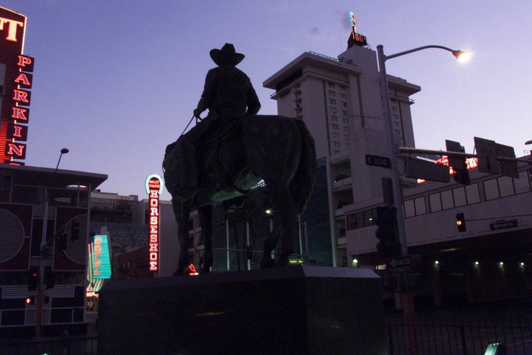 A statue of the late Benny Binion, founder of Binion's Horseshoe, looks over the downtown casino Tuesday, Aug. 14, 2001, on the 50th anniversary of the Fremont Street landmark. K.M. Cannon/Las Veg ...