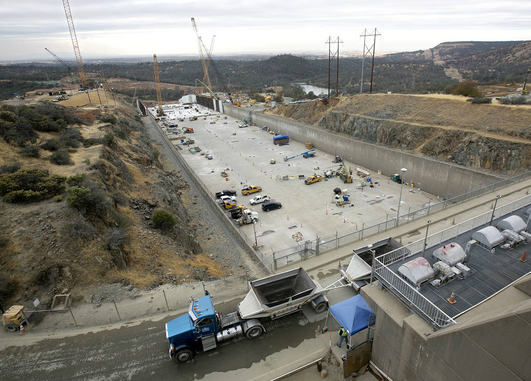 Work continues to repair the damaged main spillway of the Oroville Dam in Oroville, Calif., in October 2017. (AP Photo/Rich Pedroncelli, File)