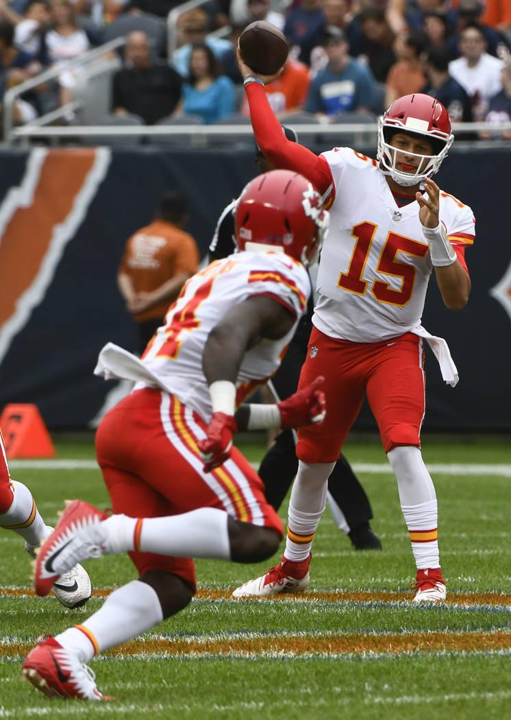Kansas City Chiefs' Patrick Mahomes throws during the first half of a preseason NFL football game Chicago Bears Saturday, Aug. 25, 2018, in Chicago. (AP Photo/Matt Marton)