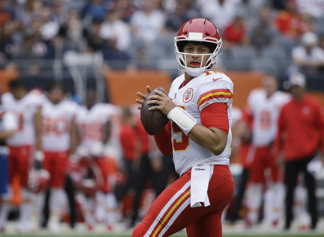 FILE - In this Aug. 25, 2018, file photo, Kansas City Chiefs' Patrick Mahomes looks for a receiver during the first half of the team's preseason NFL football game against the Chicago Bears in Chic ...
