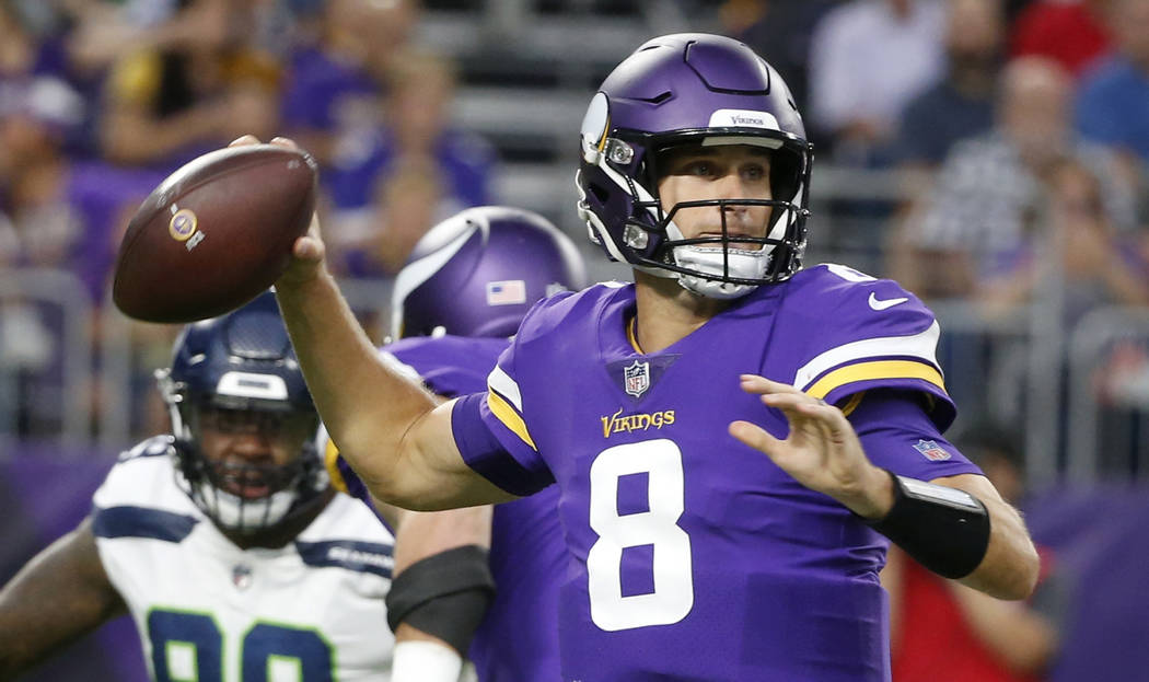 FILE - In this Friday, Aug. 24, 2018 file photo, Minnesota Vikings quarterback Kirk Cousins (8) throws a pass during the first half of an NFL preseason football game against the Seattle Seahawks ...