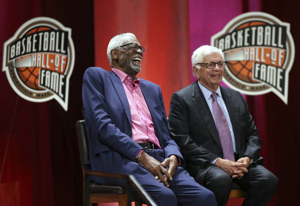 Bill Russell, left, laughs alongside David Stern as they listen to inductee Rick Welts during induction ceremonies into the Basketball Hall of Fame, Friday, Sept. 7, 2018, in Springfield, Mass. (A ...