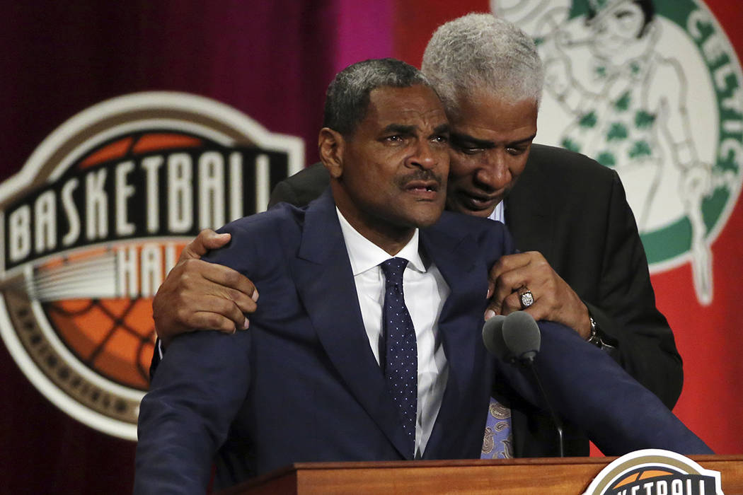 Maurice Cheeks, left, is hugged by Hall of Famer Julius Erving while speaking during induction ceremonies into the Basketball Hall of Fame, Friday, Sept. 7, 2018, in Springfield, Mass. (AP Photo/E ...