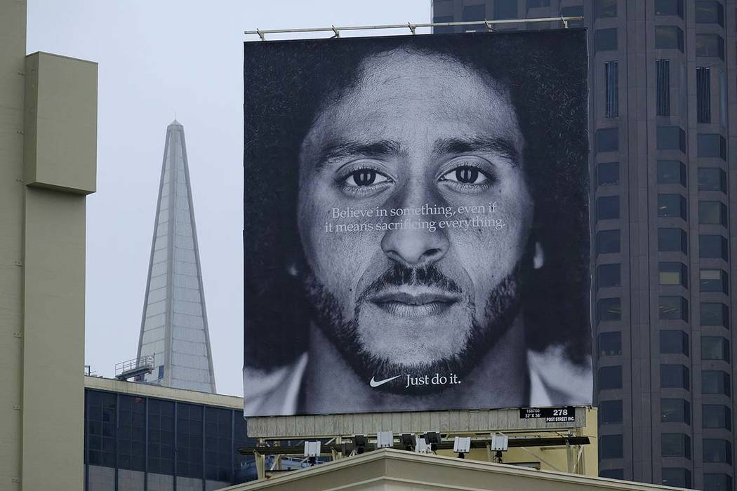 A large billboard stands on top of a Nike store showing former San Francisco 49ers quarterback Colin Kaepernick at Union Square, Wednesday, Sept. 5, 2018, in San Francisco. An endorsement deal bet ...