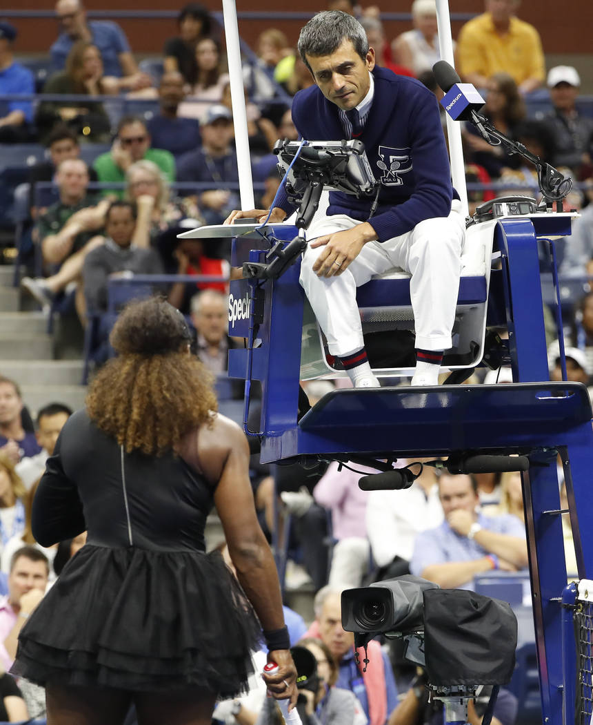 Chair umpire Carlos Ramos talks with Serena Williams during the women's final of the U.S. Open tennis tournament against Naomi Osaka, of Japan, Saturday, Sept. 8, 2018, in New York. (AP Photo/Adam ...