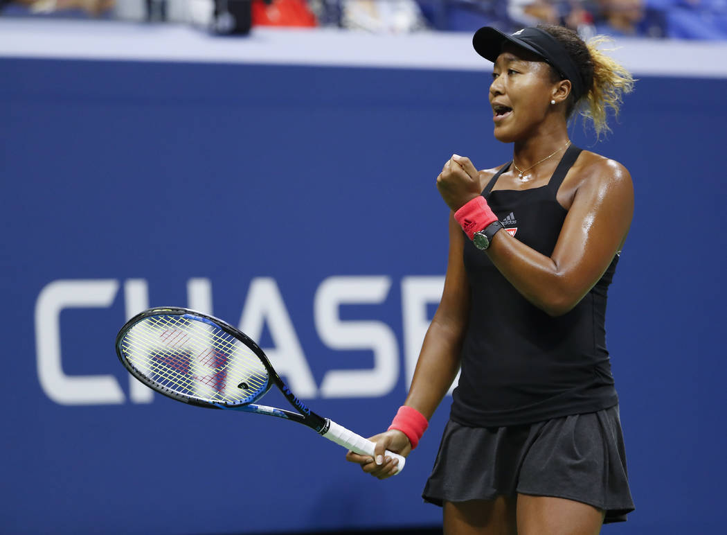 Naomi Osaka, of Japan, reacts after breaking the serve of Serena Williams during the women's final of the U.S. Open tennis tournament, Saturday, Sept. 8, 2018, in New York. (AP Photo/Adam Hunger)