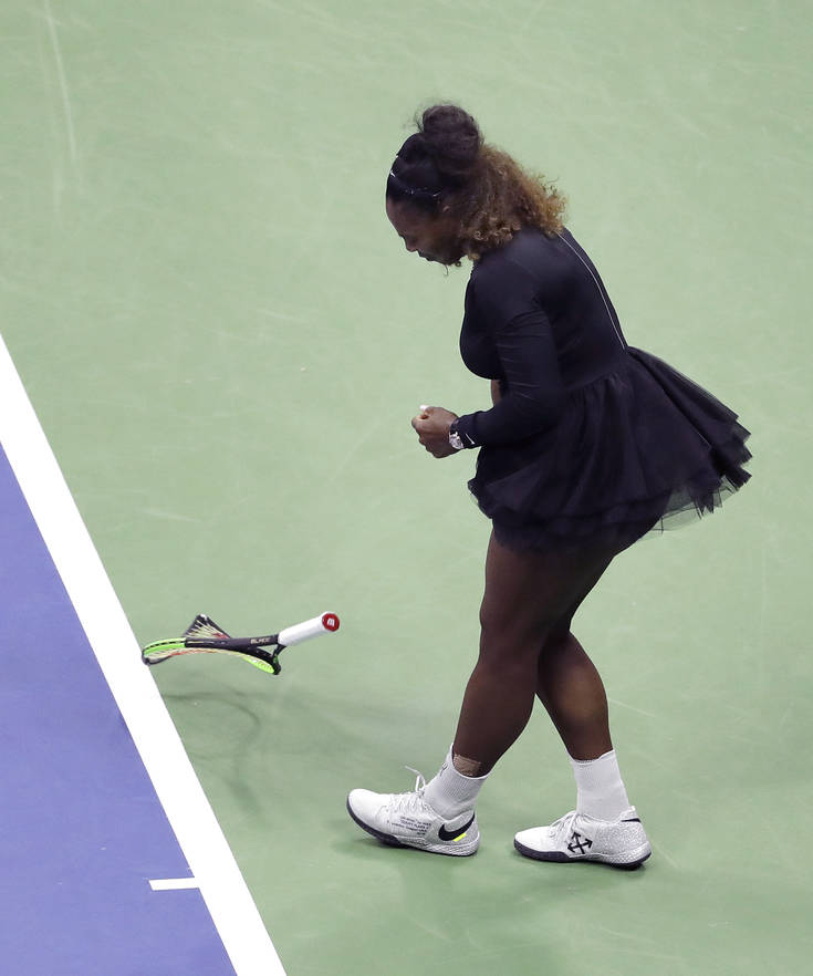 Serena Williams slams her racket on court during the women's final of the U.S. Open tennis tournament against Naomi Osaka, of Japan, Saturday, Sept. 8, 2018, in New York. (AP Photo/Seth Wenig)