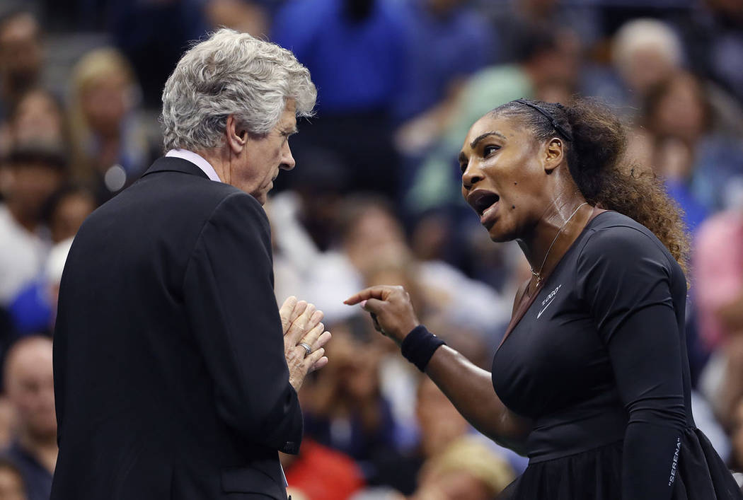 Serena Williams, right, talks with referee Brian Earley during the women's final of the U.S. Open tennis tournament against Naomi Osaka, of Japan, Saturday, Sept. 8, 2018, in New York. (AP Photo/A ...