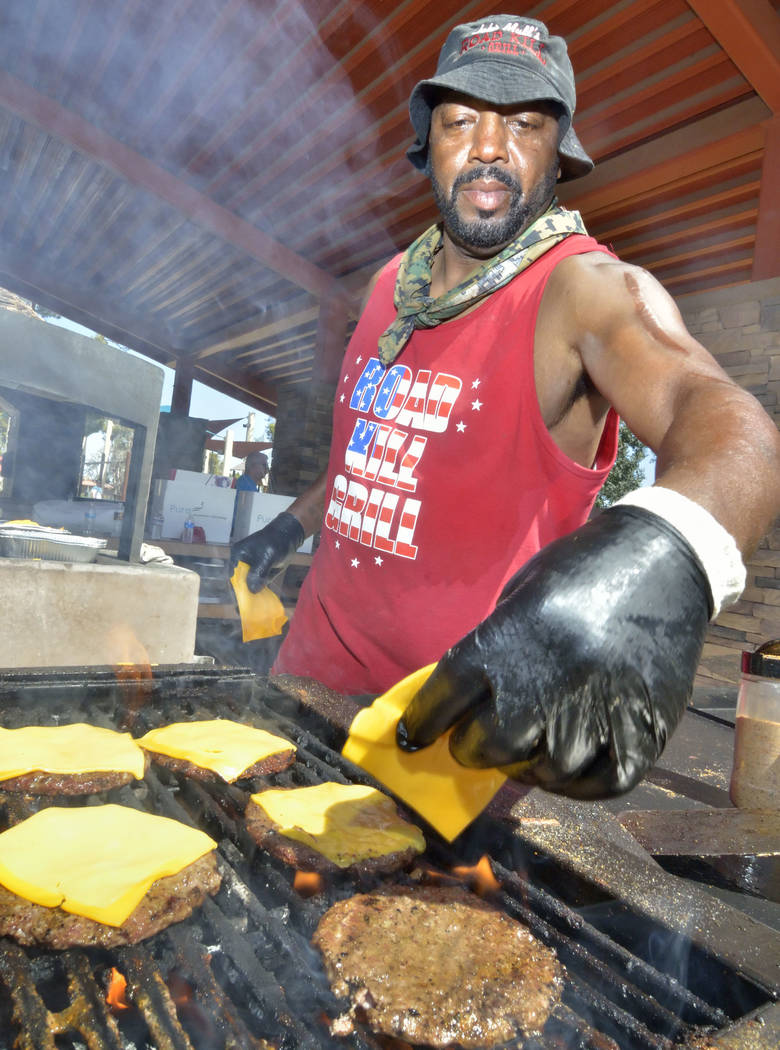 Joseph Preston of the Road Kill Grill makes cheeseburgers during the Armed Forces Military Veterans and First Responders Appreciation Day at Craig Ranch Regional Park at 628 W. Craig Road in North ...