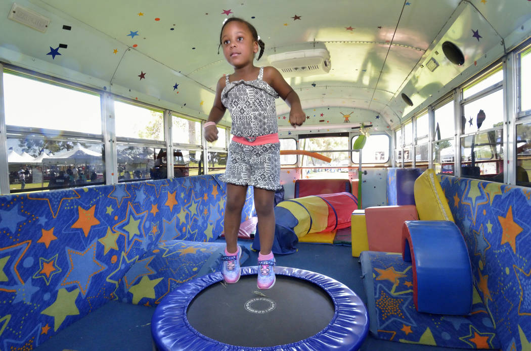Zaleia Poindexter bounces on a trampoline in the Tumble Gym Bus LV during the Armed Forces Military Veterans and First Responders Appreciation Day at Craig Ranch Regional Park at 628 W. Craig Road ...