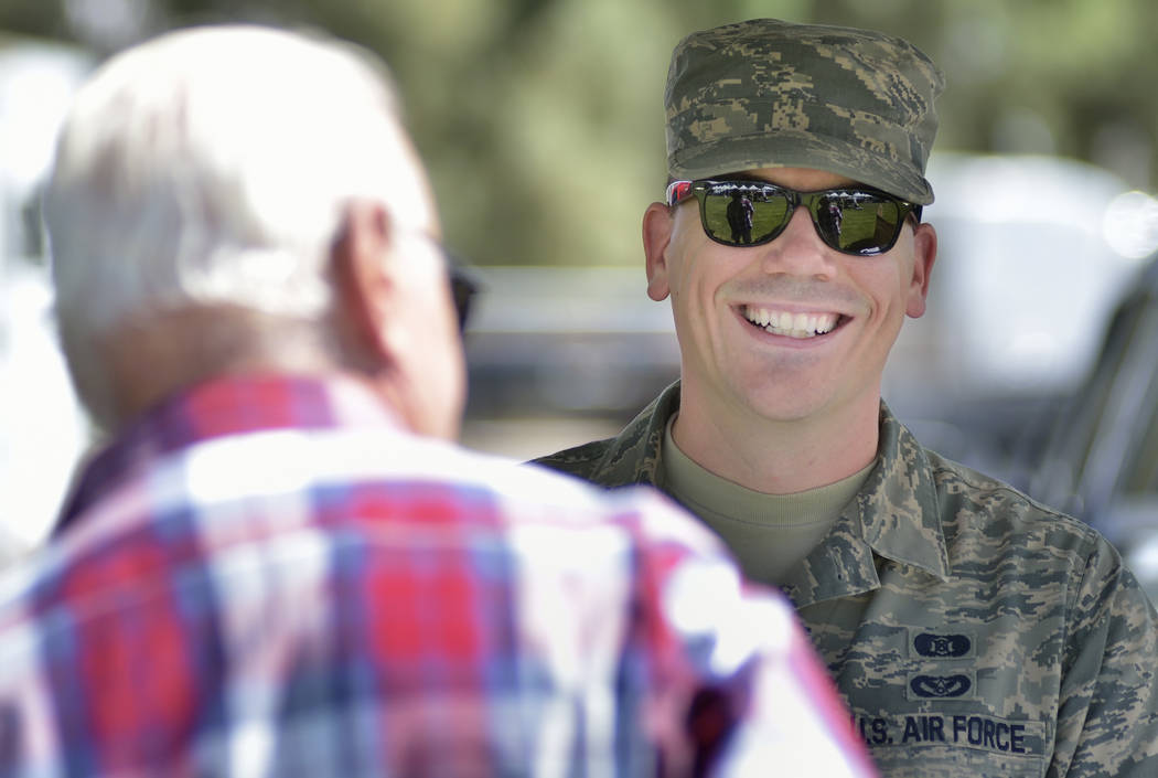 Air Force Senior Airman Jeff Novak, right, talks with Dana Smith during the Armed Forces Military Veterans and First Responders Appreciation Day at Craig Ranch Regional Park at 628 W. Craig Road i ...