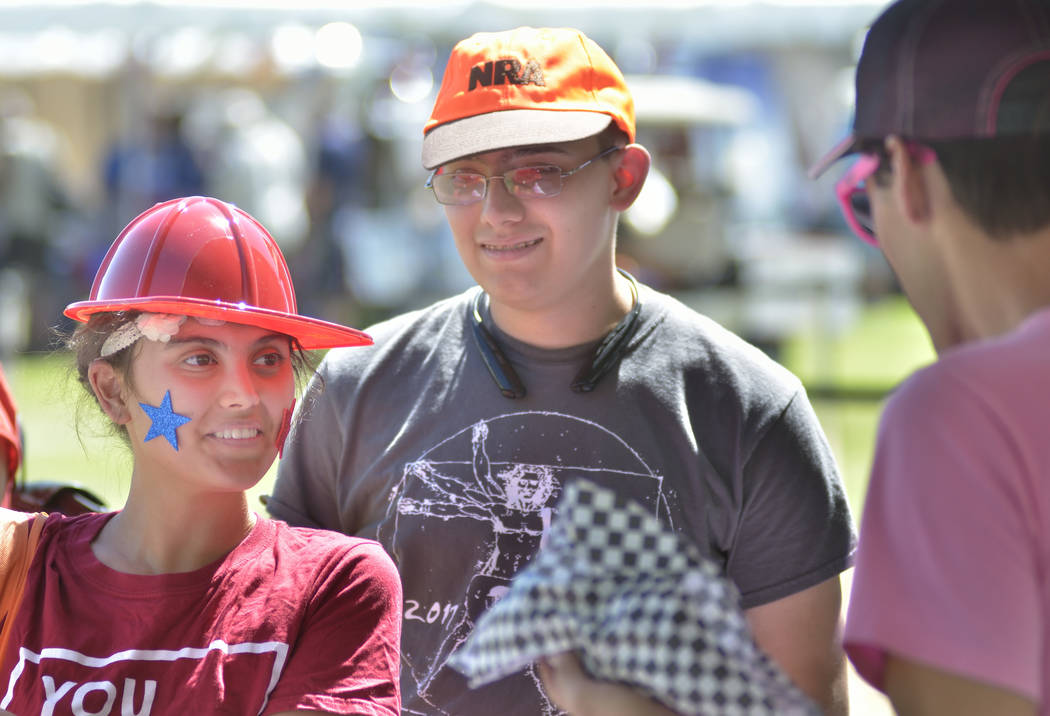 Rachel Borders, left, and her brother Joshua, center, talk with Josiah LaRow at the American Cancer Society booth at the Armed Forces Military Veterans and First Responders Appreciation Day at Cra ...