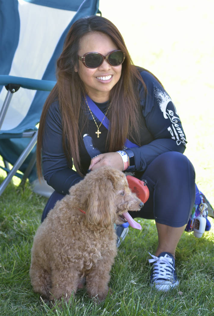 Marrisa Luke catches some shade with her dog Rex during the Armed Forces Military Veterans and First Responders Appreciation Day at Craig Ranch Regional Park at 628 W. Craig Road in North Las Vega ...