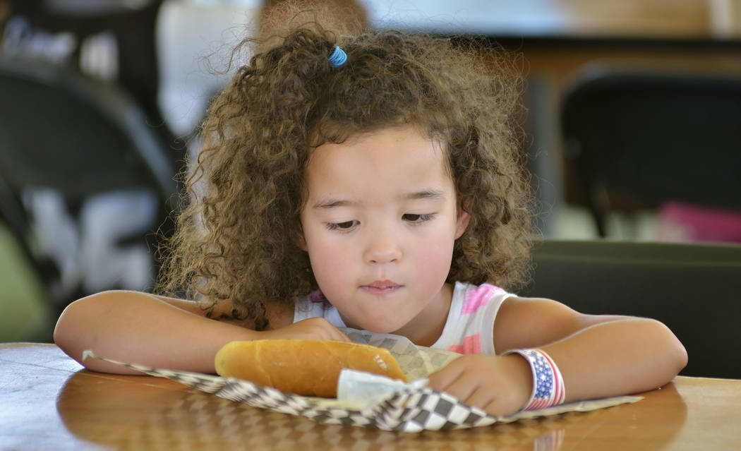 Apalonia Warner contemplates a hot dog during the Armed Forces Military Veterans and First Responders Appreciation Day at Craig Ranch Regional Park at 628 W. Craig Road in North Las Vegas on Satur ...