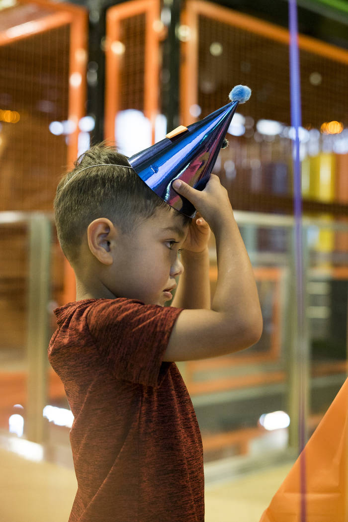 Breeze Belluomini, 4, puts on a birthday hat to celebrate the Discovery Children's Museum's birthday in Las Vegas, Sunday, Sept. 9, 2018. (Marcus Villagran/Las Vegas Review-Journal) @marcusvillagran