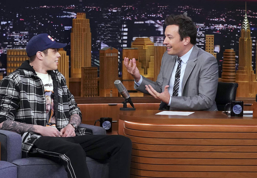 """This image released by NBC shows comedian Pete Davidson, a cast member on """"Saturday Night Live,"""" left, with host Jimmy Fallon during a taping of """"The Tonight Show Starring Jimmy Fal ..."""