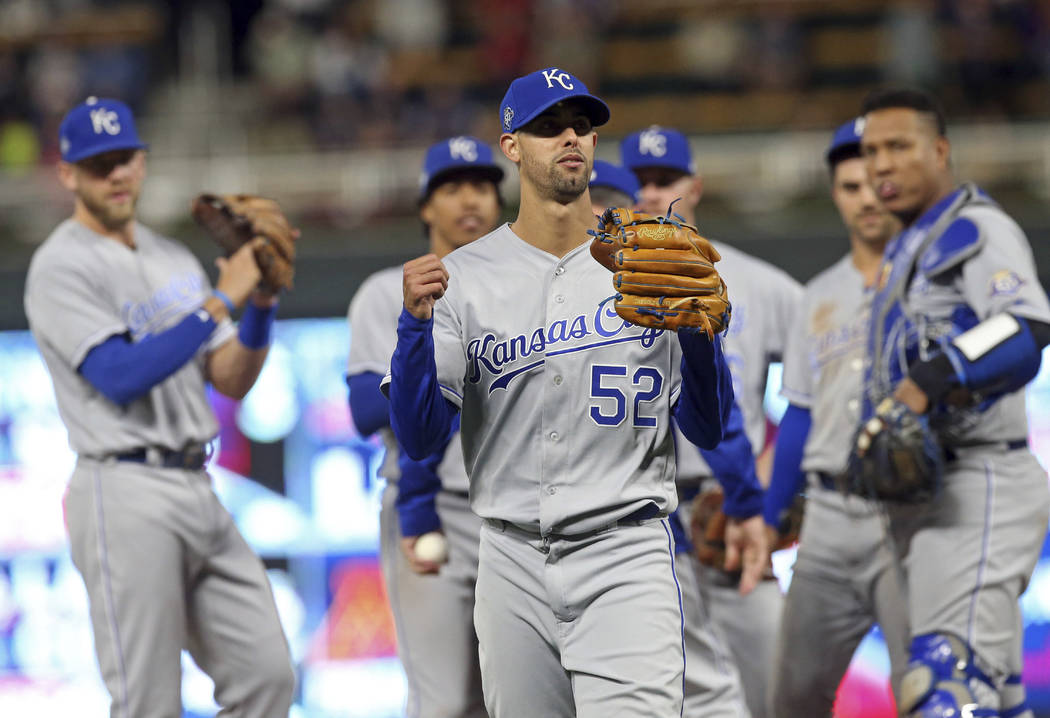 Kansas City Royals watch as pitcher Jorge Lopez, center, leaves after he was pulled in the ninth inning against the Minnesota Twins in a baseball game Saturday, Sept. 8, 2018, in Minneapolis. Lope ...