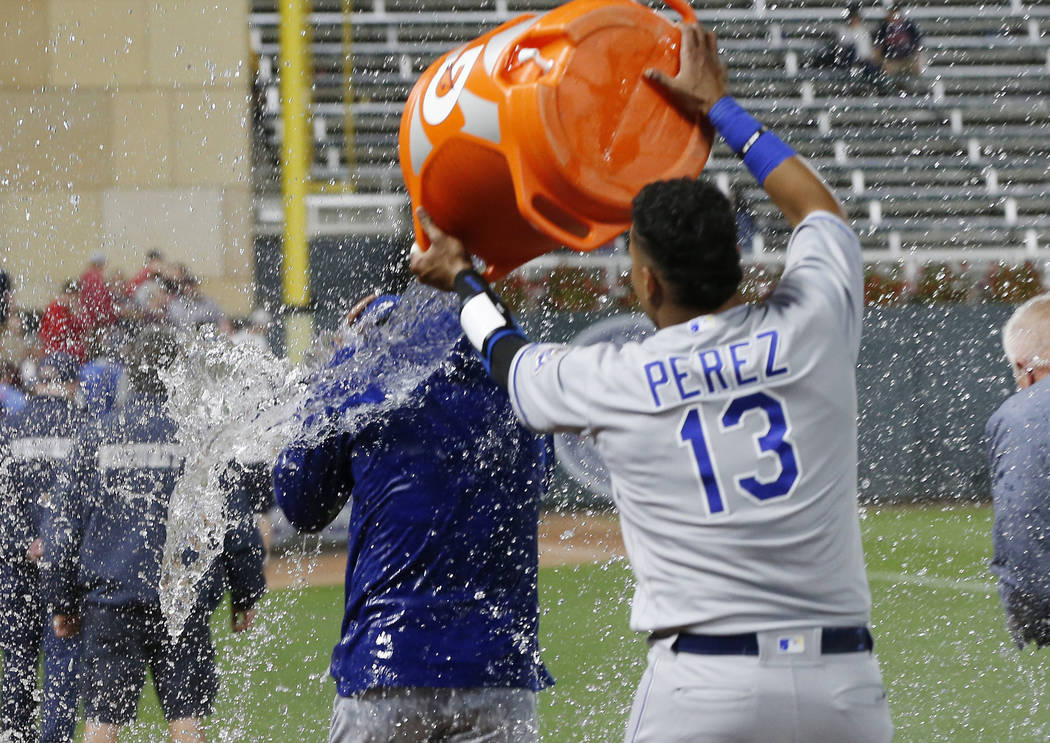 Kansas City Royals pitcher Jorge Lopez gets doused by catcher Salvador Perez, right, after a baseball game against the Minnesota Twins on Saturday, Sept. 8, 2018, in Minneapolis. Lopez had a perfe ...