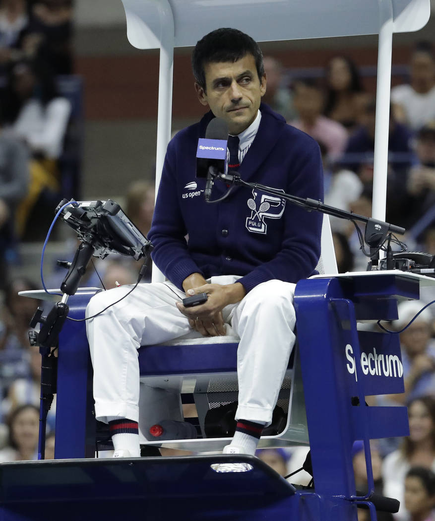 Chair umpire Carlos Ramos watches play as he officiates the match between Serena Williams and Naomi Osaka, of Japan, during the women's final of the U.S. Open tennis tournament, Saturday, Sept. 8, ...