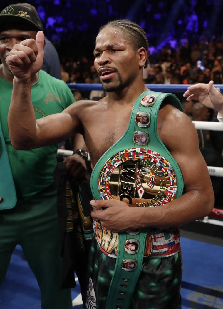 Shawn Porter gestures to supporters after a WBC welterweight championship boxing match against Danny Garcia, Sunday, Sept. 9, 2018, in New York. Porter won the fight. (AP Photo/Frank Franklin II)