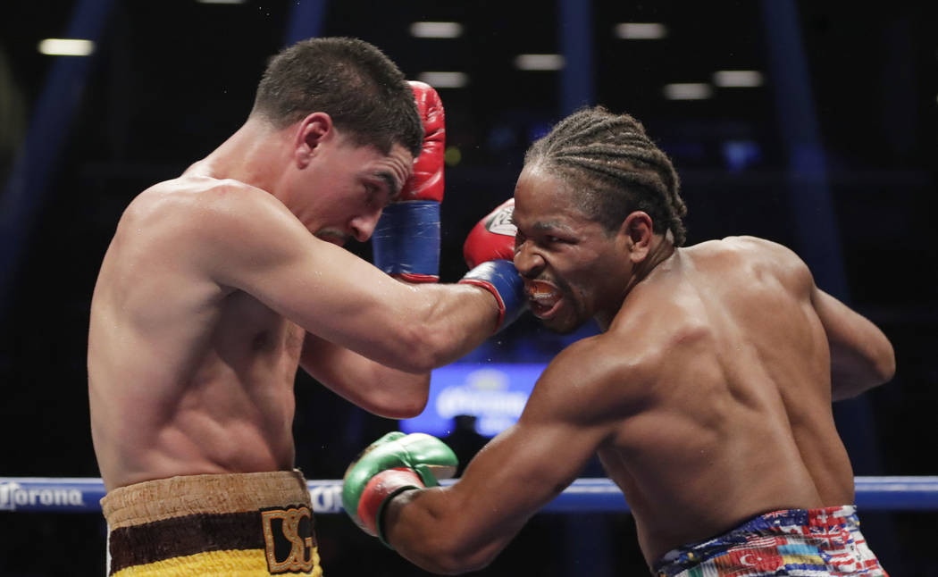 Shawn Porter, right, punches Danny Garcia during the 12th round of a WBC welterweight championship boxing match, Sunday, Sept. 9, 2018, in New York. Porter won the fight. (AP Photo/Frank Franklin II)