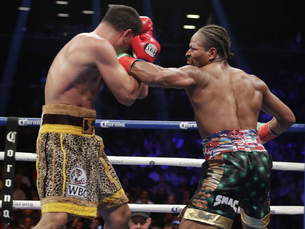 Shawn Porter, right, punches Danny Garcia during the eighth round of a WBC welterweight championship boxing match Saturday, Sept. 8, 2018, in New York. Porter won the fight. (AP Photo/Frank Frankl ...