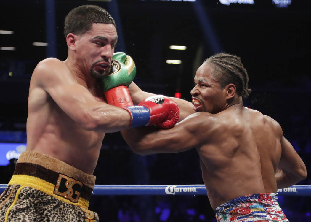 Shawn Porter, right, punches Danny Garcia during the eighth round of a WBC welterweight championship boxing match, Saturday, Sept. 8, 2018, in New York. Porter won the fight. (AP Photo/Frank Frank ...