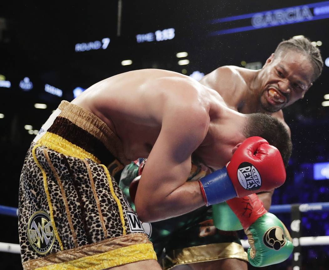 Shawn Porter, right, punches Danny Garcia during the seventh round of a WBC welterweight championship boxing match, Saturday, Sept. 8, 2018, in New York. Porter won the fight. (AP Photo/Frank Fran ...
