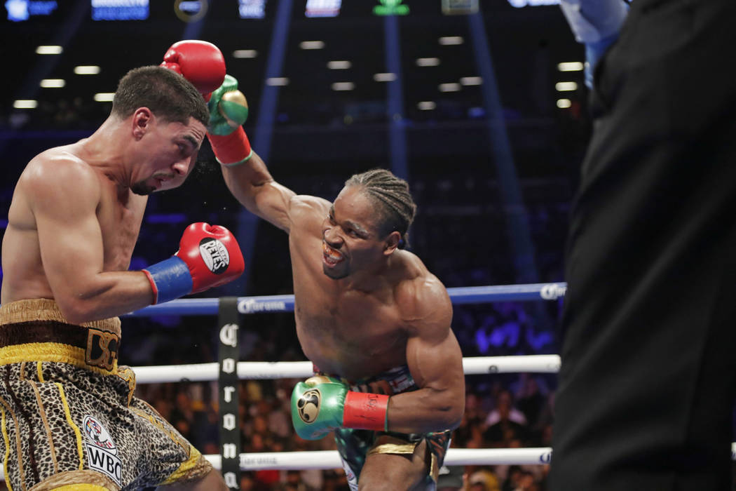 Shawn Porter, right, punches Danny Garcia during the fifth round of a WBC welterweight championship boxing match Saturday, Sept. 8, 2018, in New York. Porter won the fight. (AP Photo/Frank Frankli ...