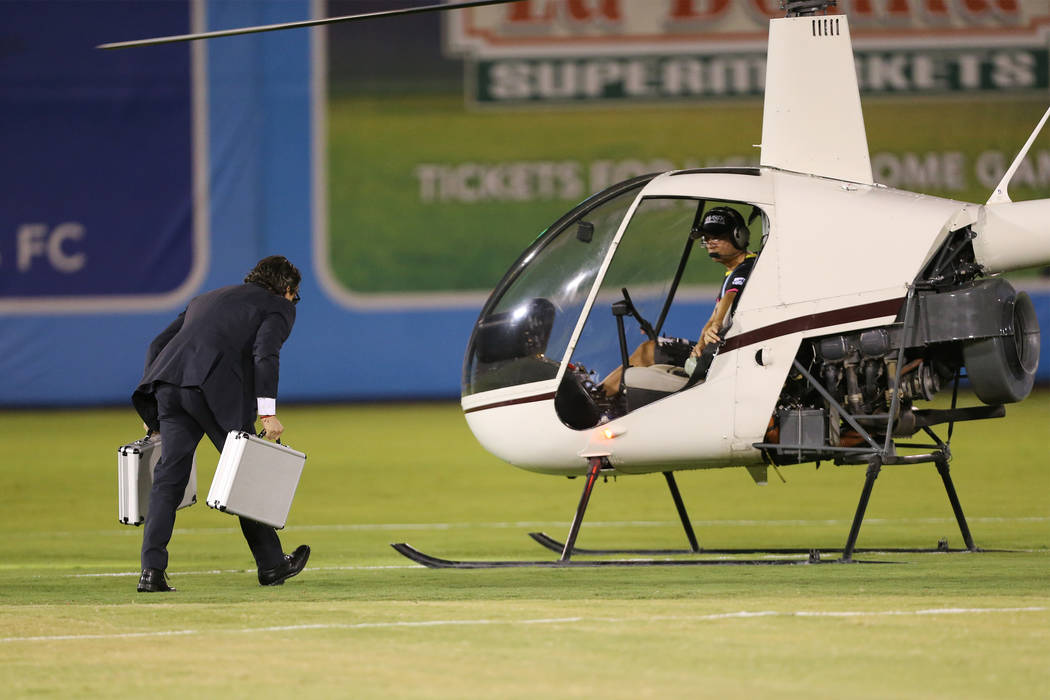 A person transfers $5,000 to helicopter for a half time cash drop during an USL soccer game between the Las Vegas Lights and LA galaxy II at Cashman Field in Las Vegas, Saturday, Sept. 8, 2018. Er ...