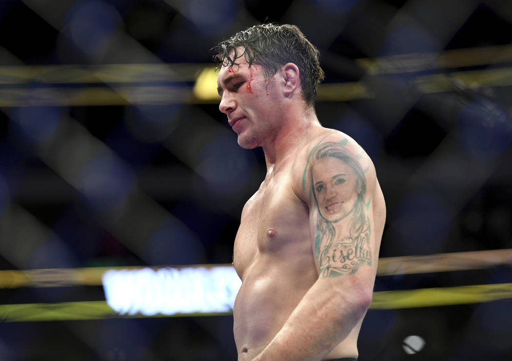 Darren Till walks back to his corner after losing by submission to Tyron Woodley in their welterweight title mixed martial arts bout at UFC 228 on Saturday, Sept. 8, 2018, in Dallas. (AP Photo/Jef ...