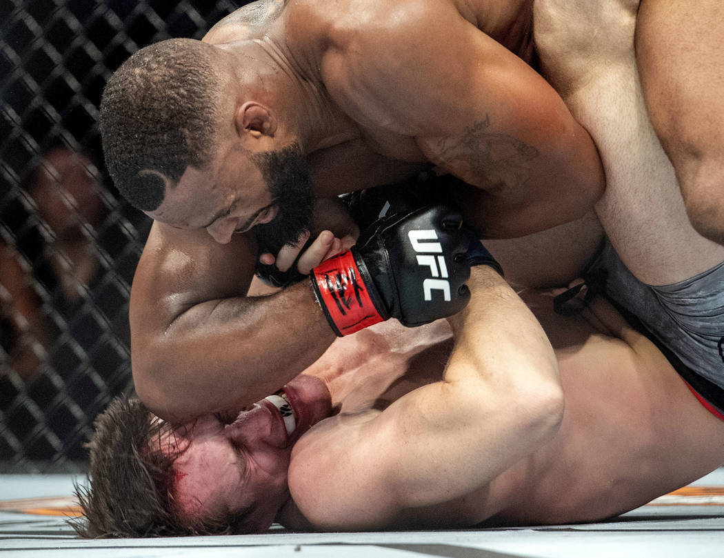 Tyron Woodley, top, elbows Darren Till in the face during their welterweight title mixed martial arts bout at UFC 228 on Saturday, Sept. 8, 2018, in Dallas. Woodley won by submission. (AP Photo/Je ...
