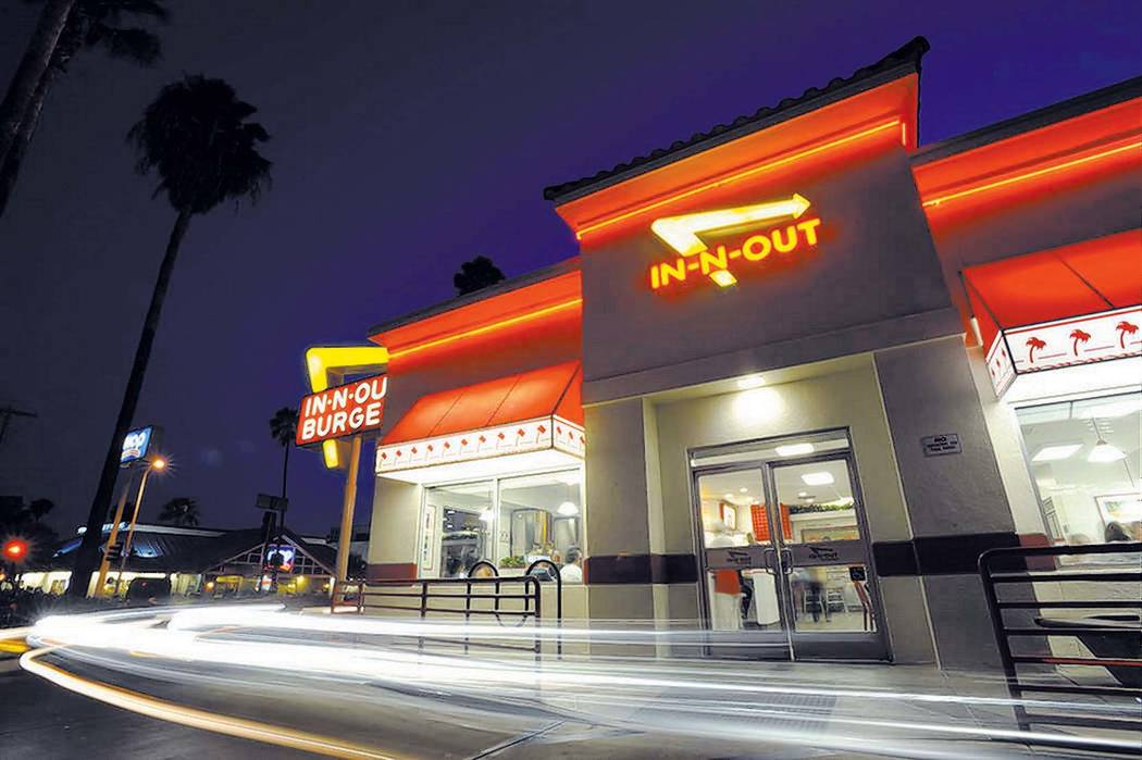 Cars exit the drive-thru at In-N-Out Burger on Friday, June 11, 2010, in the Hollywood area of Los Angeles. (AP Photo/Adam Lau)