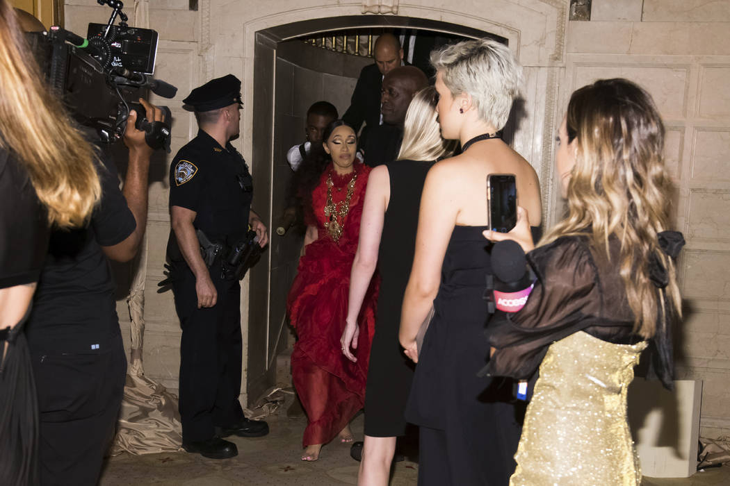 "Cardi B, with a swollen bump on her forehead, leaves after an altercation at the Harper's BAZAAR ""ICONS by Carine Roitfeld"" party at The Plaza on Friday, Sept. 7, 2018, New York. (Photo ..."