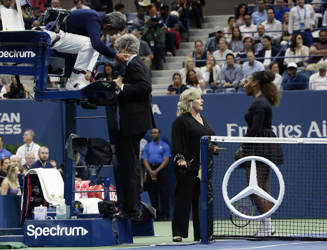 Chair umpire Carlos Ramos, left, talks with referee Brian Earley as Serena Williams talks with Donna Kelso during the women's final of the U.S. Open tennis tournament against Naomi Osaka, of Japan ...