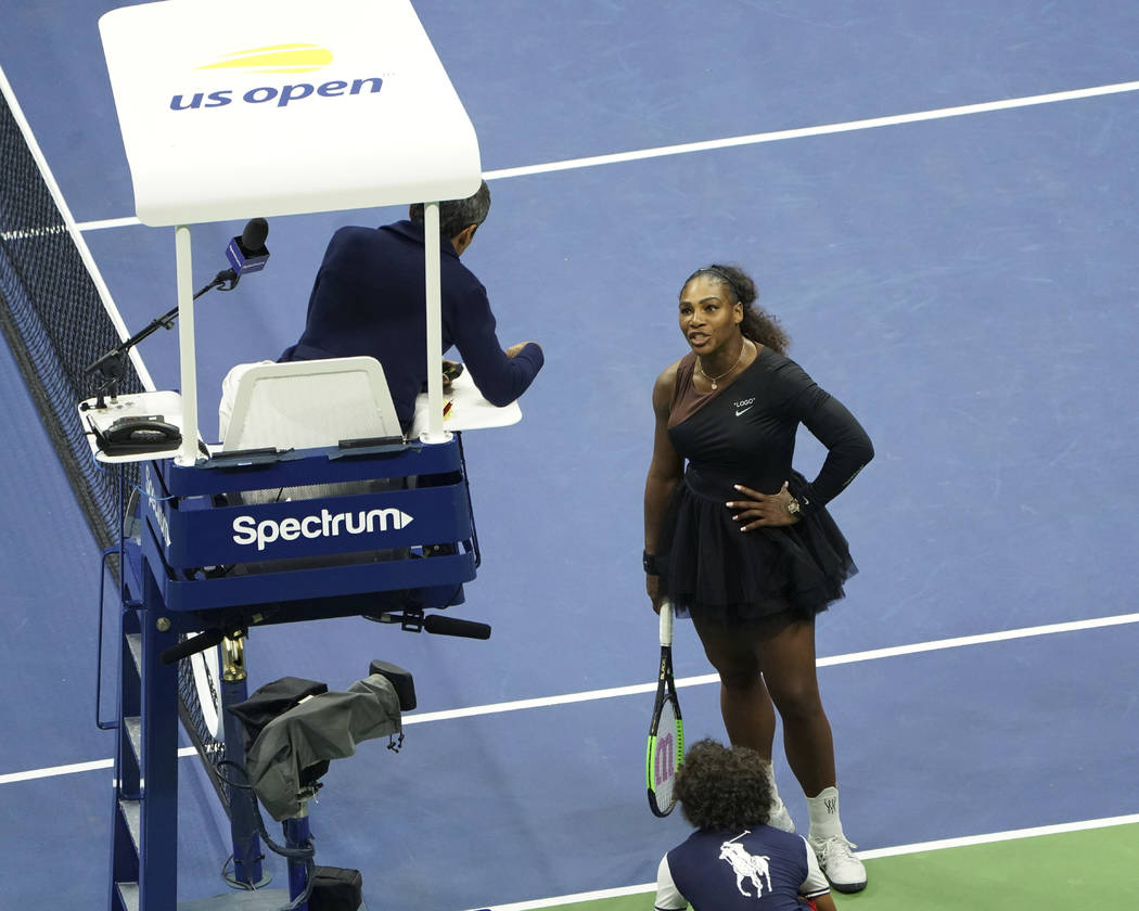 Serena Williams argues with the chair umpire during a match against Naomi Osaka, of Japan, during the women's finals of the U.S. Open tennis tournament at the USTA Billie Jean King National Tennis ...