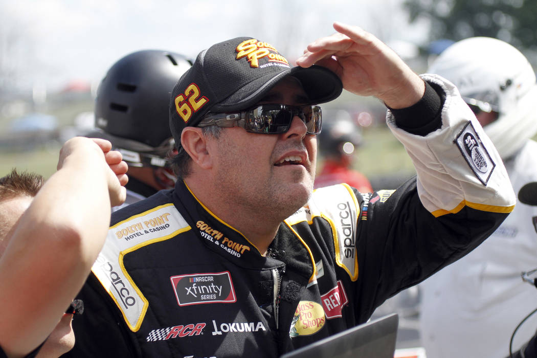 Brendan Gaughan is seen on pit road before qualifying for a NASCAR Xfinity series auto race at Mid Ohio Sports Car Course in Lexington, Ohio, Saturday, Aug. 11, 2018. (AP Photo/Tom E. Puskar)