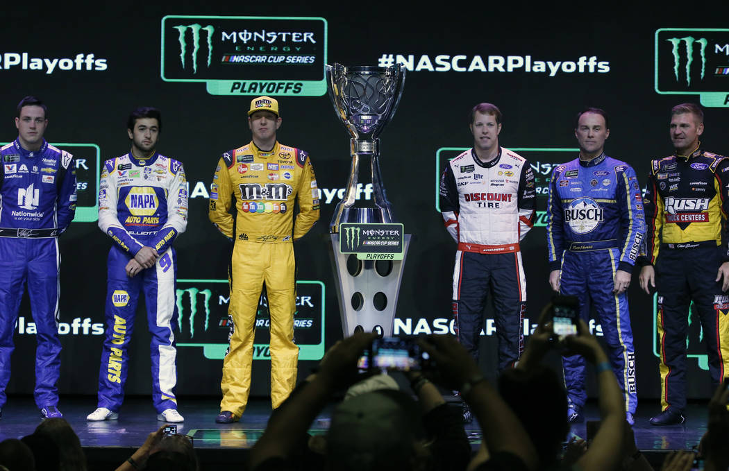 NASCAR drivers, including Kyle Busch, third left, and Brad Keselowski, third right, pose for photo after the NASCAR playoffs south point 400 news conference on Thursday, Sept. 13, 2018, in Las Veg ...