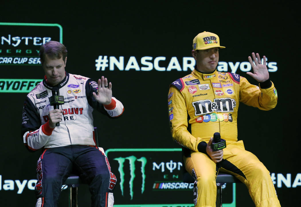NASCAR drivers Brad Keselowski, left, and Kyle Busch wave to the crowd during the NASCAR playoffs south point 400 news conference on Thursday, Sept. 13, 2018, in Las Vegas. (Bizuayehu Tesfaye/Las ...