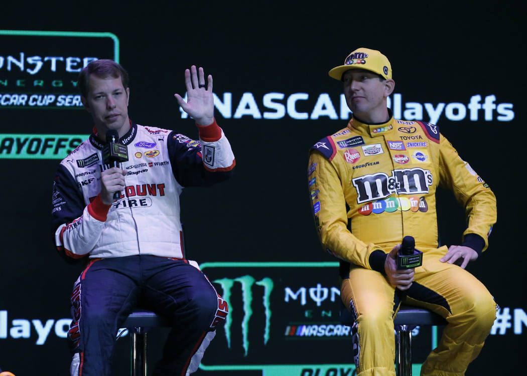 NASCAR driver Brad Keselowski, left, speaks as Kyle Busch, looks on during the NASCAR playoffs south point 400 news conference on Thursday, Sept. 13, 2018, in Las Vegas. (Bizuayehu Tesfaye/Las Veg ...
