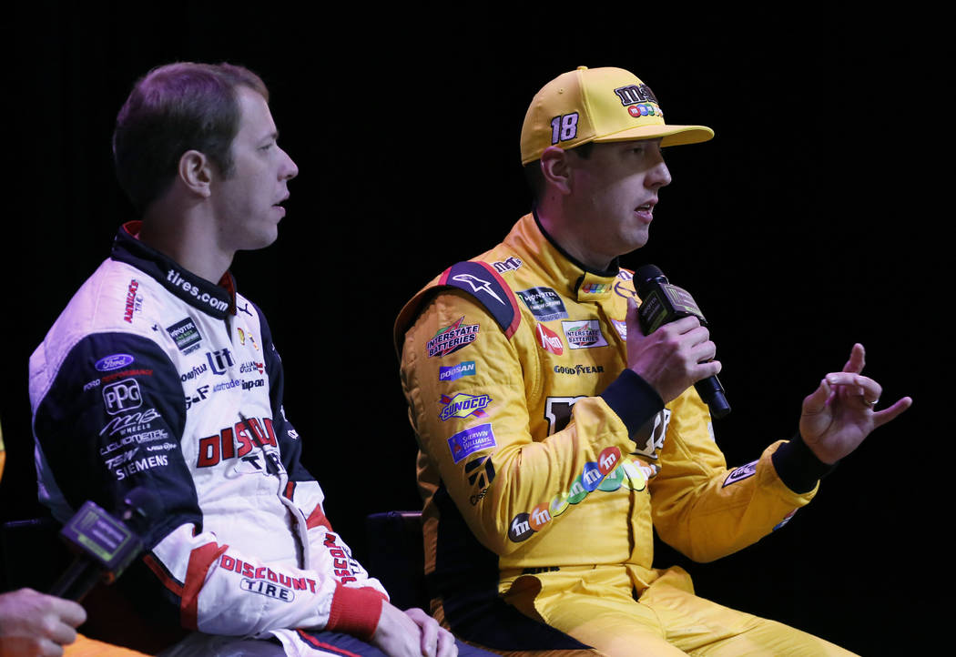 NASCAR driver Kyle Busch, right, speaks as Brad Keselowski looks on during the NASCAR playoffs south point 400 news conference on Thursday, Sept. 13, 2018, in Las Vegas. (Bizuayehu Tesfaye/Las Veg ...