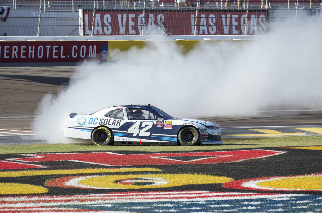Race car driver Ross Chastain of Florida celebrates with a burnout after winning the DC Solar 200 NASCAR Xfinity Series race at the Las Vegas Motor Speedway on Saturday, Sept. 15, 2018. Richard Br ...