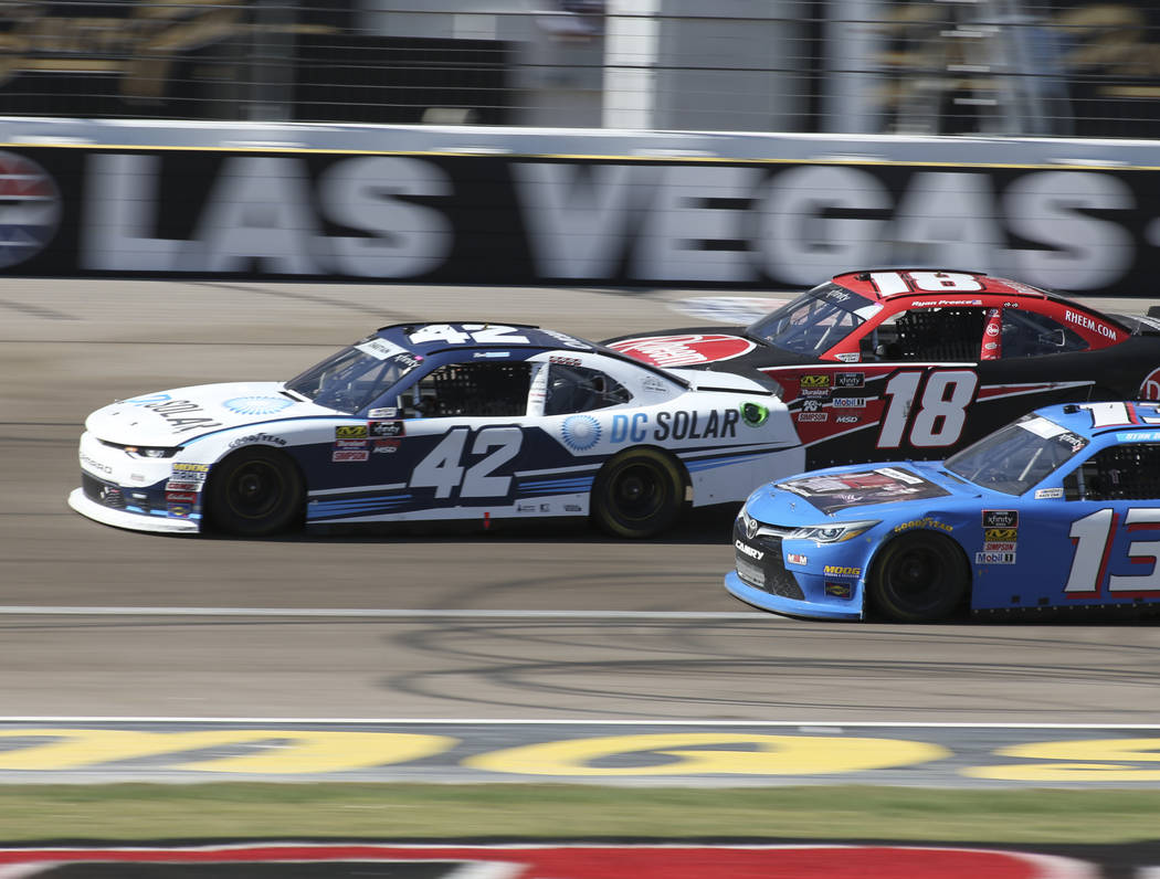 Ross Chastain (42) squeezes through Ryan Preece (18) and Stan Mullis (13) during the DC Solar 300 NASCAR Xfinity Series race at the Las Vegas Motor Speedway on Saturday, Sept. 15, 2018. Richard Br ...
