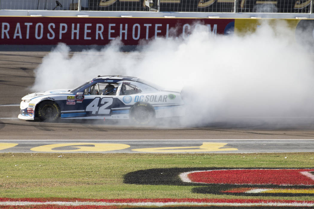 Race car driver Ross Chastain of Florida celebrates with a burnout after winning the DC Solar 300 NASCAR Xfinity Series race at the Las Vegas Motor Speedway on Saturday, Sept. 15, 2018. Richard Br ...