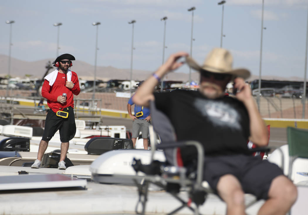 Spectators watch the action from atop motor homes parked in the infield during the DC Solar 300 NASCAR Xfinity Series race at the Las Vegas Motor Speedway on Saturday, Sept. 15, 2018. Richard Bria ...