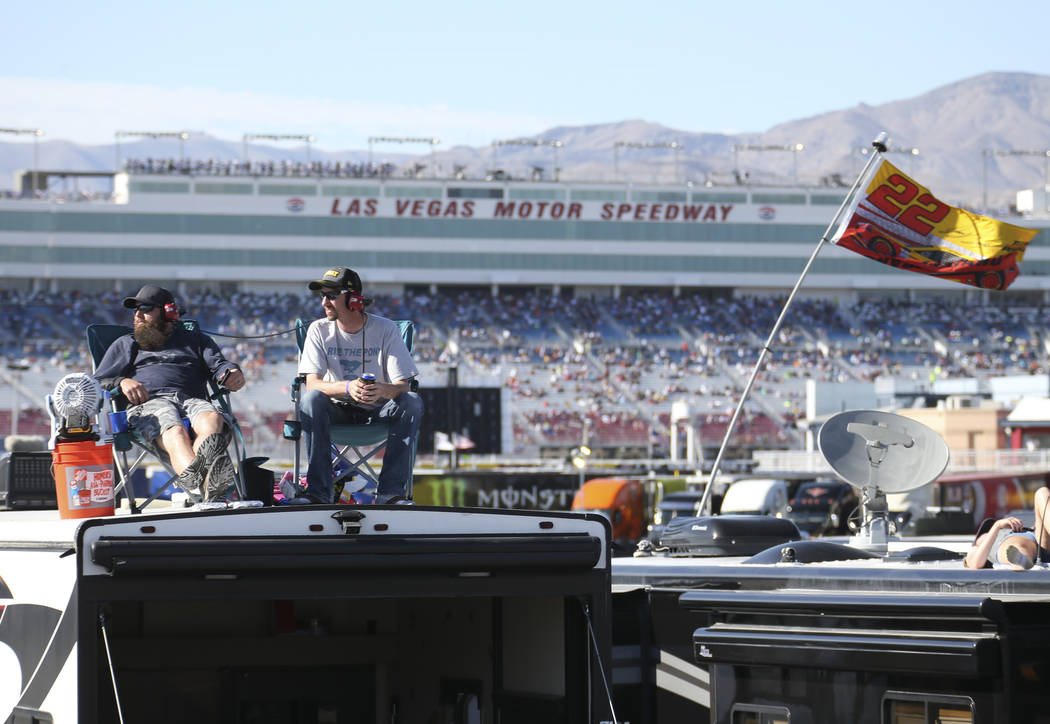 Las Vegas residents Ray Costopoulos, left, and James Brixey watch the action from atop their motor home parked in the infield during the DC Solar 300 NASCAR Xfinity Series race at the Las Vegas Mo ...