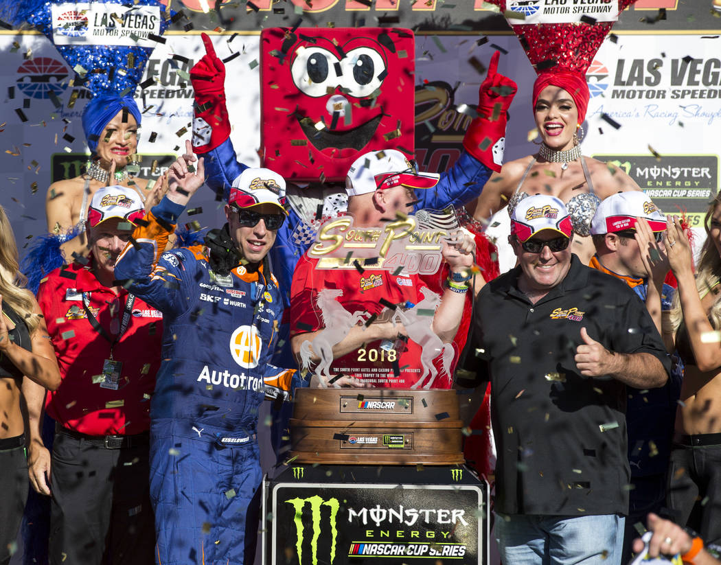 Race car driver Brad Keselowski, left, celebrates in victory lane with grand marshal Brendan Gaughan after winning the South Point 400 NASCAR Cup Series auto race at the Las Vegas Motor Speedway i ...