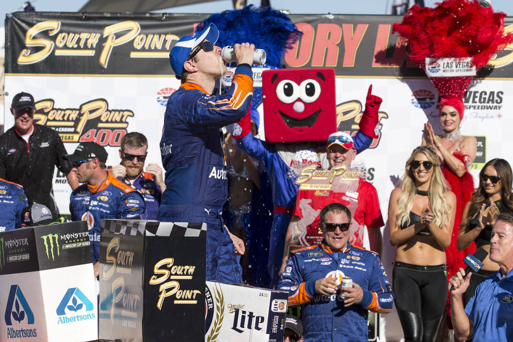 Race car driver Brad Keselowski celebrates with a beer in victory lane after winning the South Point 400 NASCAR Cup Series auto race at the Las Vegas Motor Speedway in Las Vegas on Sunday, Sept. 1 ...